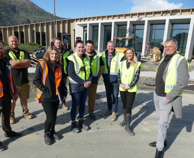 In front of the nearly-complete Southern Cross CLT hospital are (from left) architect Tomasz...