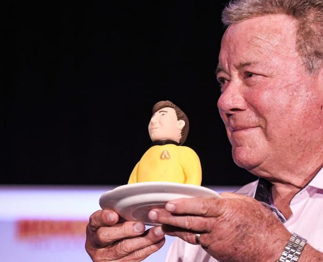 William Shatner with part of a birthday cake depicting him as Captain Kirk given to him at...