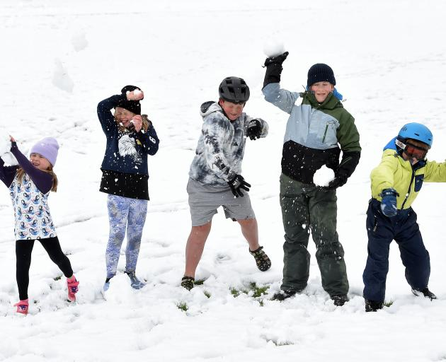 Having a snow fight on the Naseby Recreational Reserve yesterday are (from left) Macy Harmes (6),...