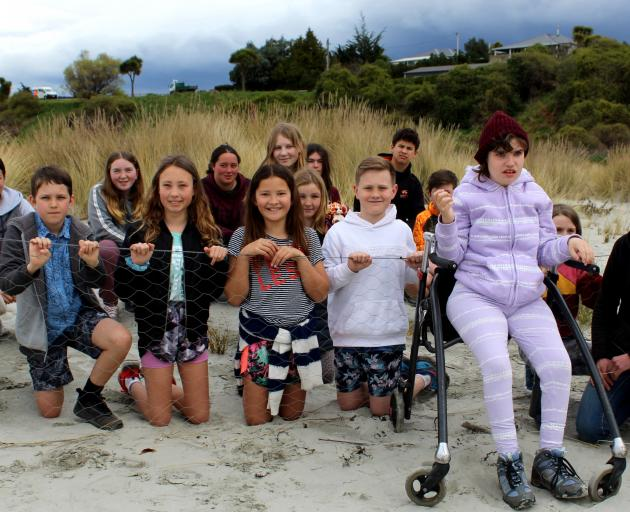 Okahau dune project organiser Angelina Young (far right) and Warrington School pupils were at...
