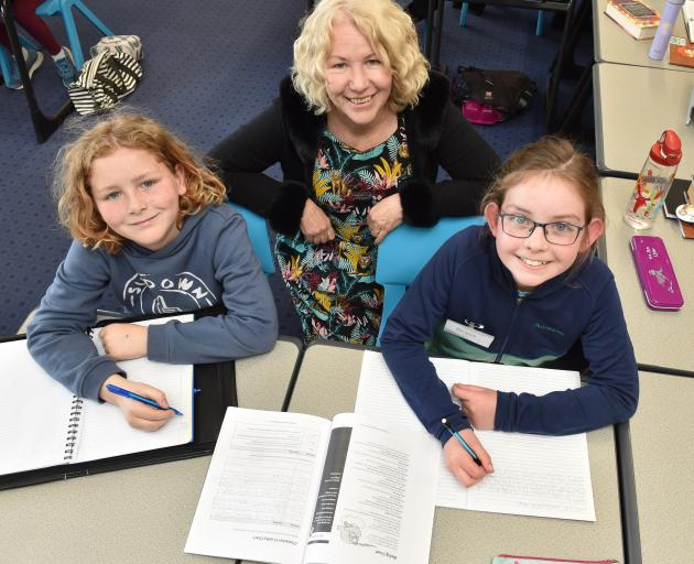 Working on their creative writing at the Write Like an Author workshop at Otago Girls' High...