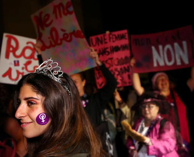 Women prepare to go on strike in Lausanne. Photo: Reuters