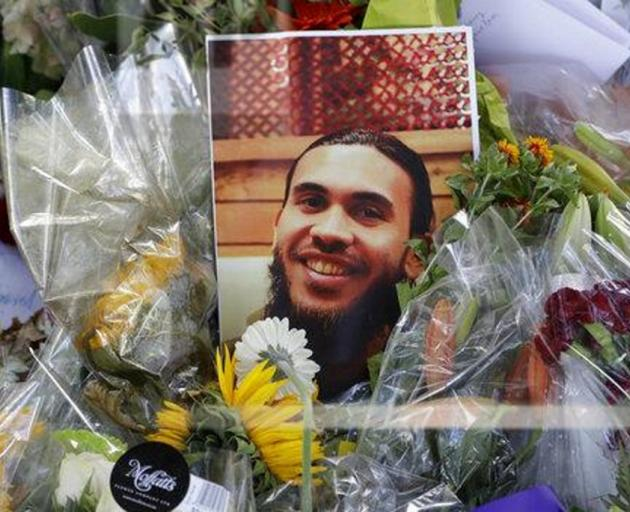 A photo tribute for Tariq Omar near the Al Noor mosque in Christchurch. Conspiracy theories...