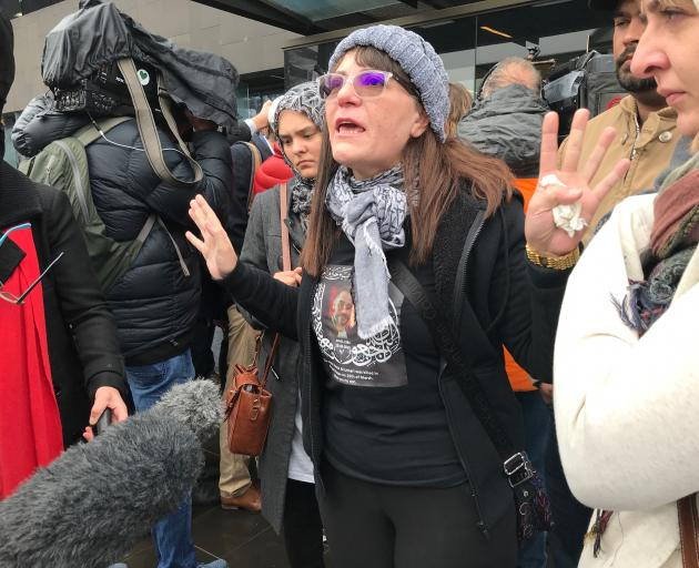 Janna Ezat, wearing a T-shirt in memorial of her son who was killed at Al Noor mosque on March 15, reacts outside the Christchurch High Court after the accused gunman pleaded not guilty to all charges. Photo: Reuters