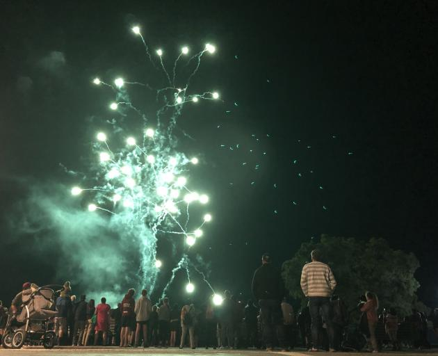 Revellers enjoy the fireworks in Te Anau. Photo: Laura Smith
