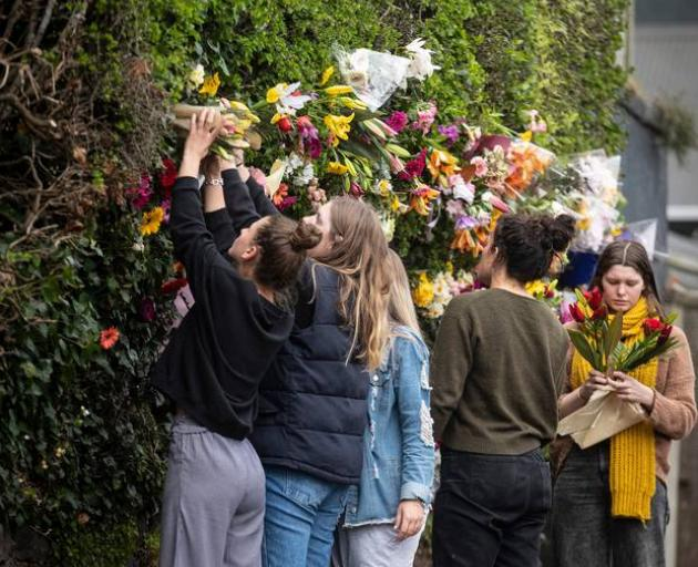 Flowers left in the hedge of the house in North Dunedin where student Sophia Crestani was...