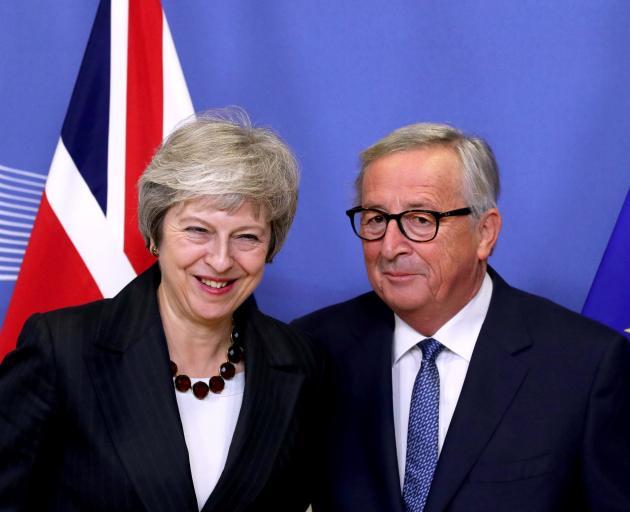 Theresa May and Jean-Claude Juncker. Photo: Reuters