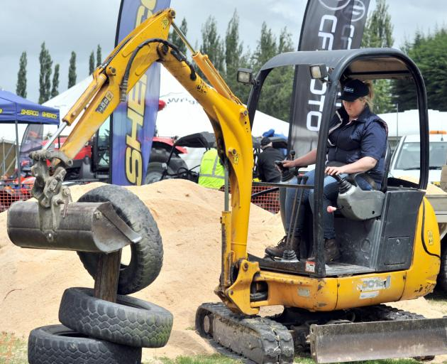 Ann Linton takes part in the mini digger section at the Young Farmer of the Year Otago district...