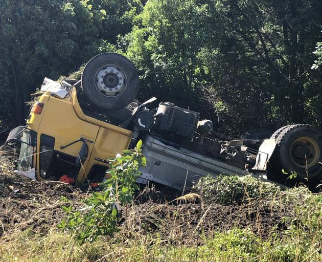 The truck ended upside down off the Southern Motorway. Photo: Supplied