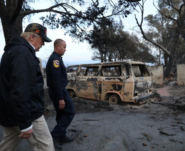 Donald Trump visited an area destroyed by the Woolsey Fire in Malibu. Photo: Reuters