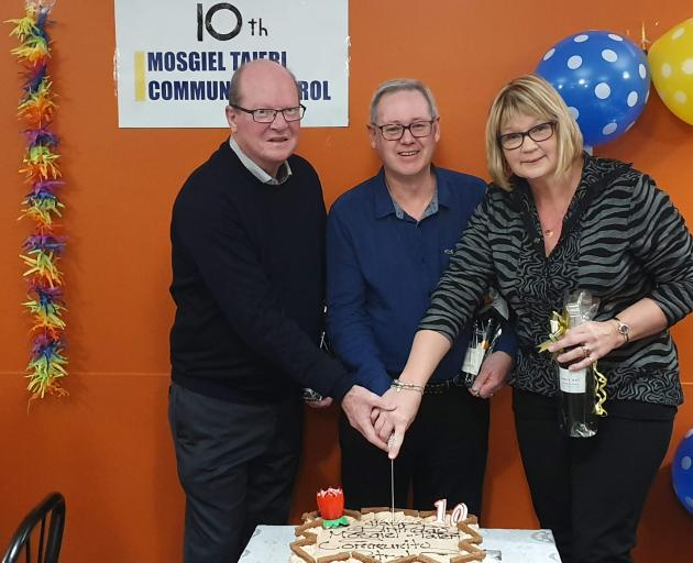 Cutting a cake at the celebration of the 10th anniversary of the Mosgiel-Taieri Community Patrol...