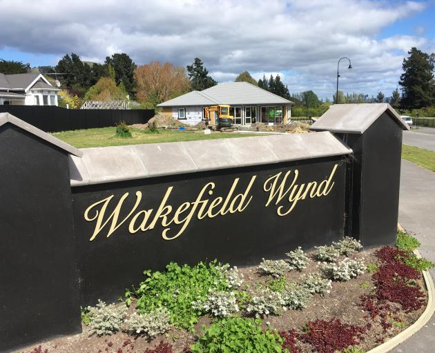 A fence with the name Wakefield Wynd at the entrance to a new subdivision off Riccarton  Rd East....