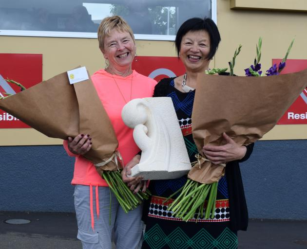 Retiring Fairfield School teachers Jan Lee (left) and Lyn Donaldson display presents given to...