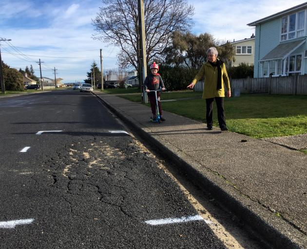 Jean Brown, of Mosgiel, points out damaged road seal to her grandson Jaxon McKay (8), of...