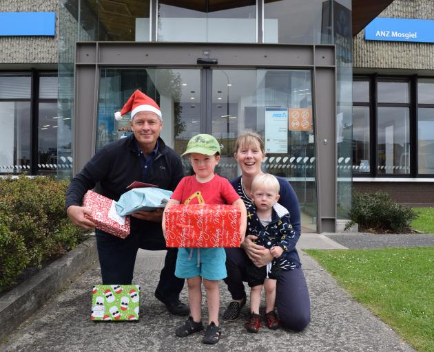 Rotary Club of Taieri member David Glen and Kelly Kleeber and her boys Cooper (3) and Ashton (1)...