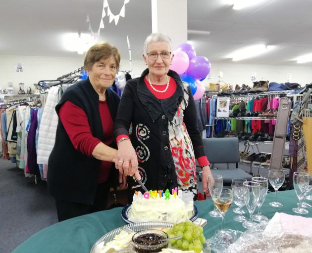 The Hospice Shop, in Mosgiel, long-time volunteers Daphne Parsons and Elisabeth Govaerts cut the...