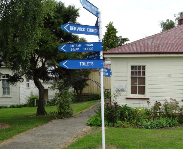 The Taieri Historical Museum and Park signpost points the way to many buildings from the early...