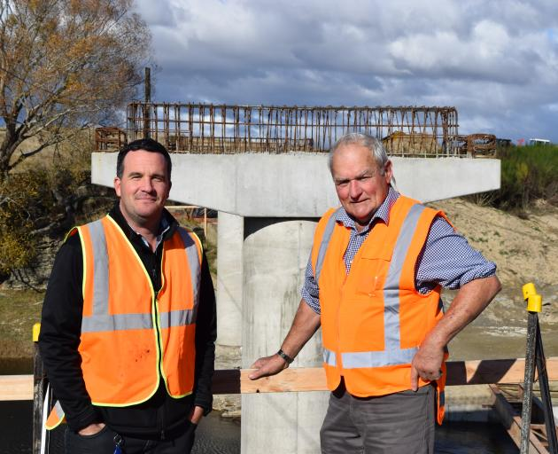 Inspecting the rebuilding of a replacement bridge near Sutton last week are Dunedin City Council...