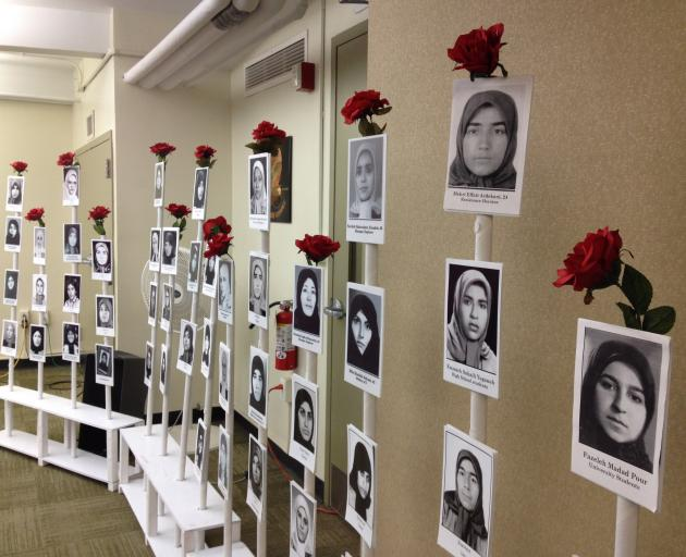 Photographs of slain Iranian female activists at an NGO parallel event at the Commission on the...