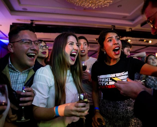 From left: Daniela Chomba, Samuel Cervantes, Katie Aragon, and Maria Praeli cheer as they watch...