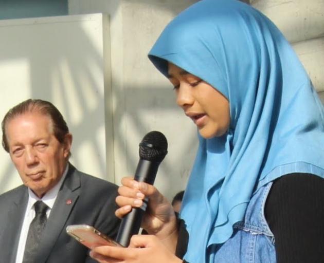 Mayor Tim Shaldbolt listens as Aisha Abdul-Jabbar, the daughter of Imam Reza Abdul Jabbar, speaks...