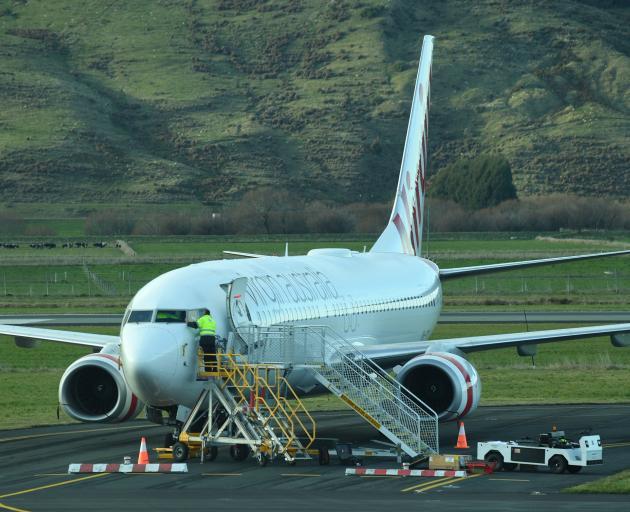 The stricken Virgin aircraft still on the tarmac at Dunedin airport this morning. Photo: Stephen Jaquiery