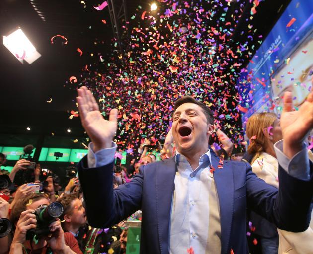 A jubilant Volodymyr Zelenskiy in Kiev on Sunday. Photo: Reuters