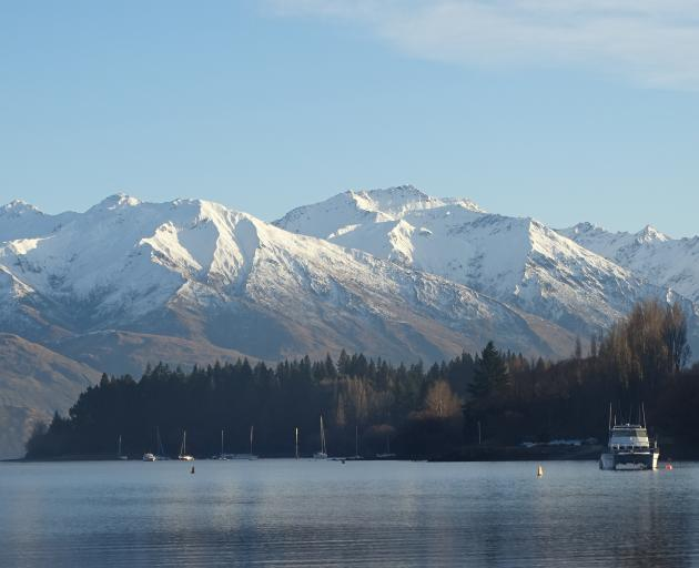 Morning sun hits Eely Point - a popular, sheltered boating and picnicking area near Wanaka on a...