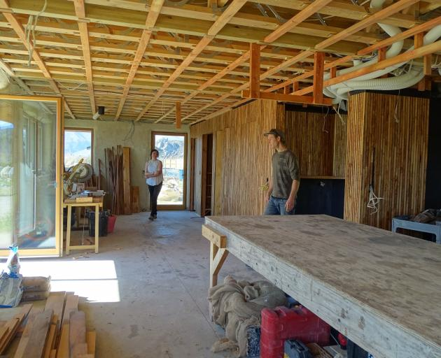 Jessica and Ben Eyers in the main room of their yet to be certified passive straw bale house.