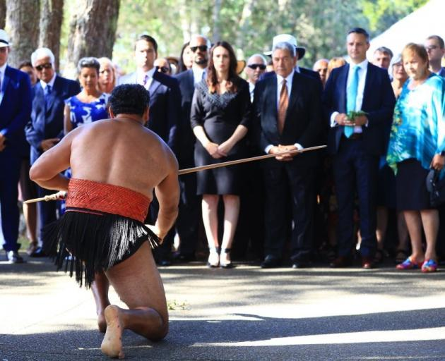 Prime Minister Jacinda Ardern (centre) and other party leaders are welcomed at Waitangi this...