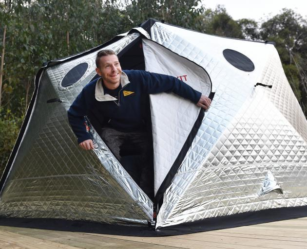Patrick Brunelle emerges from the shiftpod, which is on a raised platform and used as a bedroom...