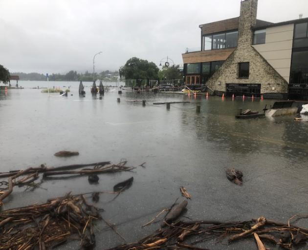 Water laps near businesses on the waterfront in Wanaka on Sunday morning. Photo: Kerrie Waterworth