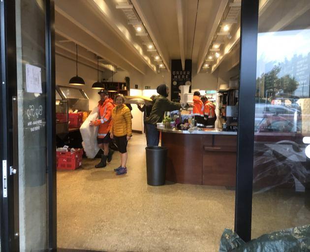 People clear out items and furniture from Big Fig in Wanaka this morning. Photo: Kerrie Waterworth