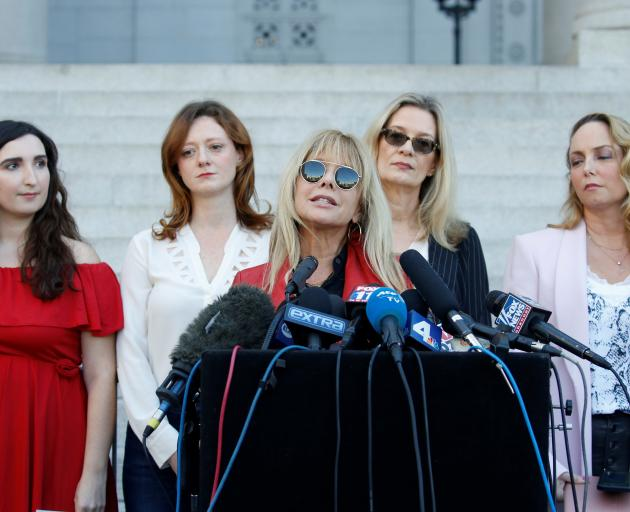 """Rosanna Arquette speaks with """"The Silence Breakers"""", from left, Sarah Ann Masse, Lauren O'Connor,..."""
