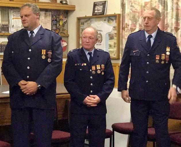 Ian Gregory Wells (centre) has been honoured by his fellow firefighters following his drowning...