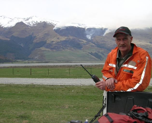 Wanaka Doc rural fire officer Paul Hondelink in the Matukituki Valley in 2007, with the West Wanaka Station fire in the background. Photo: ODT