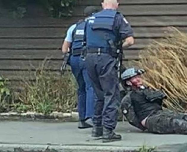 The moment the accused Christchurch mosque gunman was dragged from his car and arrested. Photo:...