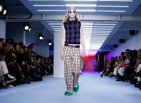 Models present creations during the Ashley Williams catwalk show at London Fashion Week in London...
