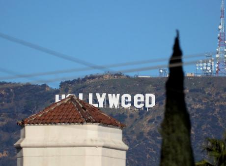 """The iconic Hollywood sign in Los Angeles was vandalised to read """"Hollyweed"""". Photo: Reuters"""
