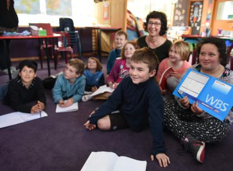 Poet Sue Wootton, pictured  with members of her Karitane School poetry class, says the process of...