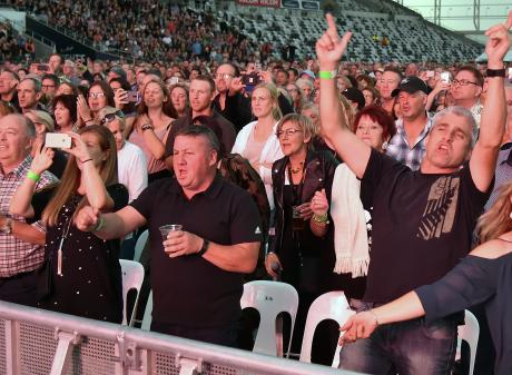 Part of the 16,000-strong crowd at Saturday night's Robbie Williams concert at Forsyth Barr...