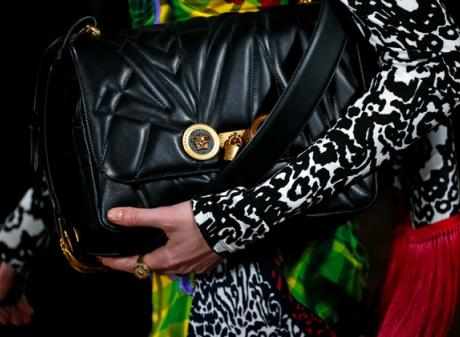 A model presents a creation from the Versace Autumn/Winter 2018 women collection during Milan...