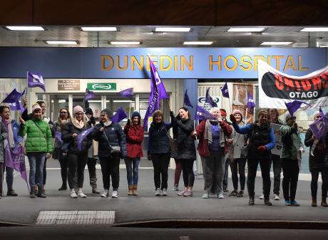 Striking nurses form a picket line in front of Dunedin Hospital on Thursday morning. Photo:...