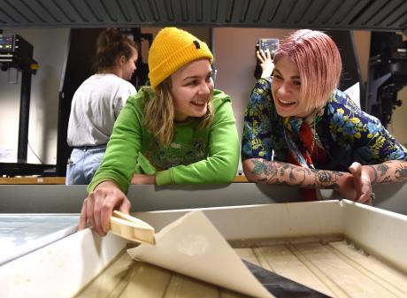 Rachel Allan (right) talks to  first-year photography student Imogen Salvage (21) in the dark...
