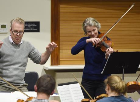 Violinist Tessa Petersen rehearses her solo with the Dunedin Symphony Orchestra and conductor...