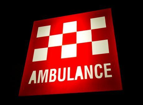 Australian Ambulance sign illuminated at night. Photo: Getty Images