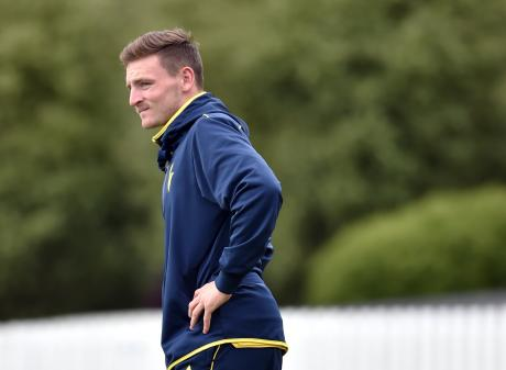 Otago all-rounder Nathan Smith stretches his injured hip flexor during a training session at the ...