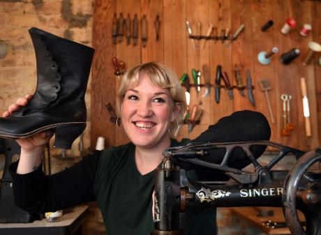Dunedin shoemaker Flora Knight shows off one of the boots she worked on for television show The...