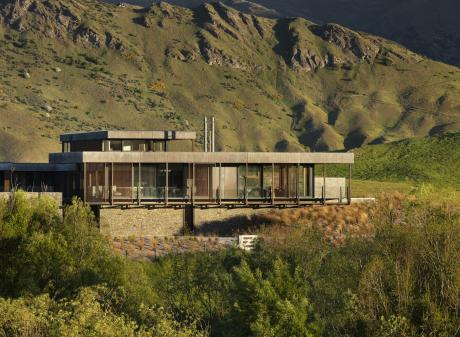 Corten steel, shuttered concrete and schist give this Speargrass Flat home a rustic look and help...