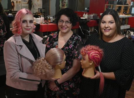 Hairdressing apprentices Rebekah Morton (left) and Tash Williamson (right) display their award...